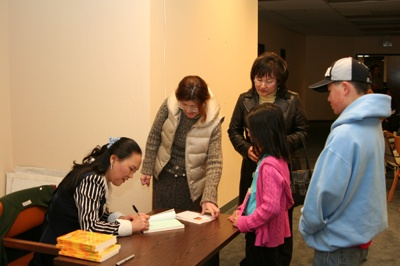 Dr Koo signs her new book