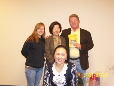Dr Koo with an Adroit College student and her family